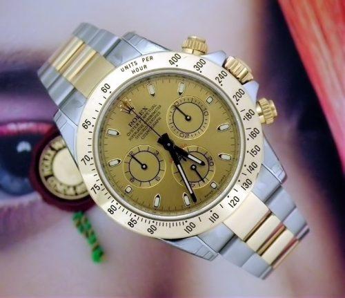 Unworn 2013 steel & gold Rolex Daytona ref 116523