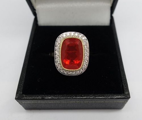 Ladies 18ct gold Diamond cluster ring with a Fire Opal centre