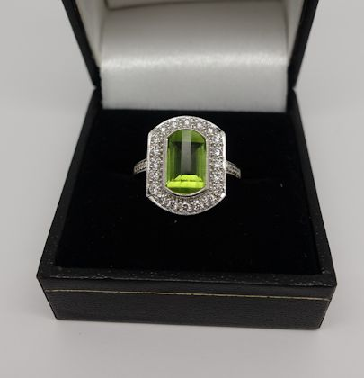 Ladies White gold Diamond cluster ring with a Peridot Centre