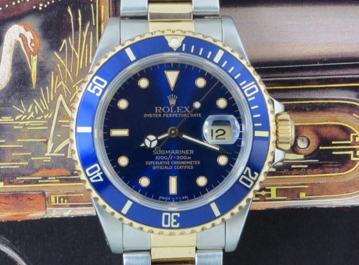 16613 Rolex Submariner steel & gold with box & paper
