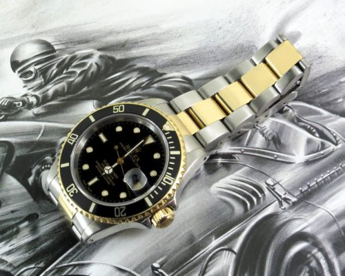 Steel & gold black kit Rolex Submariner with paper