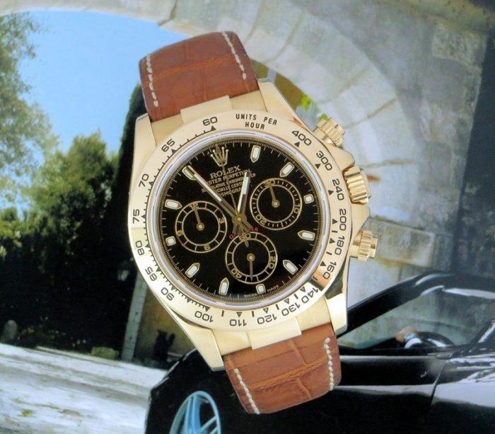Mint 18ct gold Rolex Cosmograph Daytona box & paper